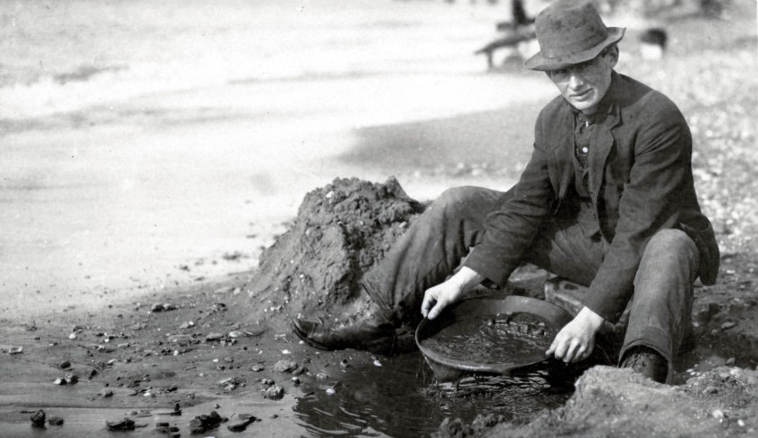 man panning gold on nome beach_01