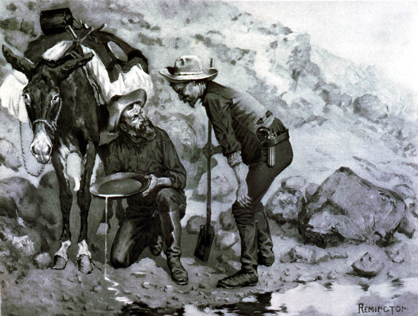 two miners panning for gold.